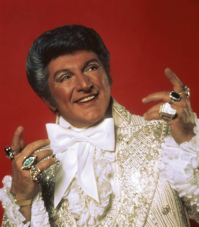 Liberace, a man and his rings.