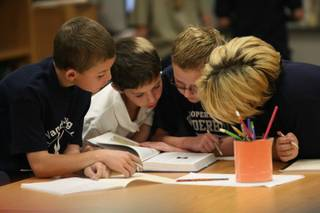 Vanderburg Elementary School fourth graders, from left, Trey Hulburt, 9, Jeffrey Downer, 10 Alex Sigman, 10, and Cody Butler, 10, gather research for a project put on by GATE instructor William Gilluly Friday.