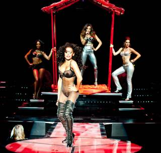 Peepshow opening publicity photo, featuring Mel B., in front, with singers. The production is at Planet Hollywood Resort and Casino in Las Vegas.