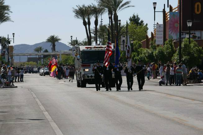 Members of the Henderson Fire Department pass the crowd during Henderson's annual Heritage Parade on Water Street.