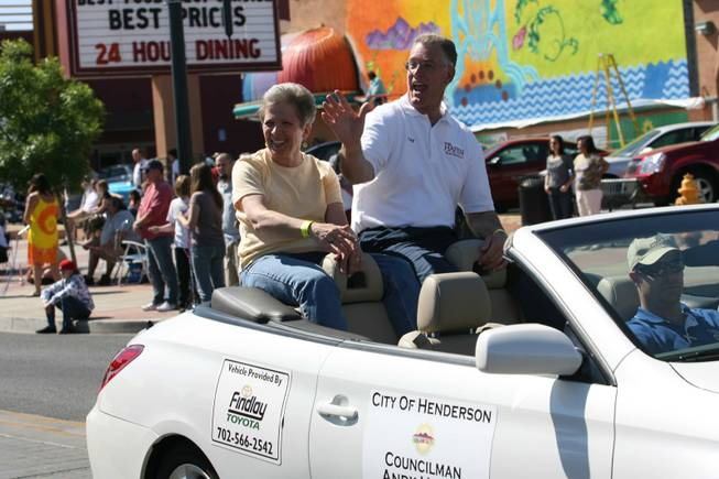 Henderson Mayoral candidate Andy Hafen and his wife Debi ride in a car during Henderson's annual Heritage Parade.