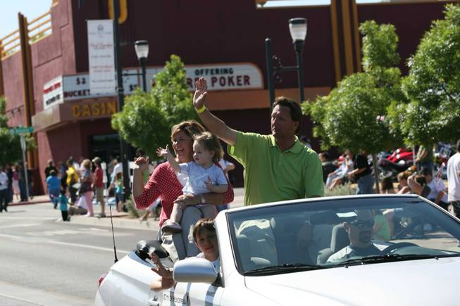 Henderson Mayoral candidate Steve Kirk, right, with his wife, Amy, and granddaughter Annie ride in a vehicle during the Heritage Parade on Water Street.