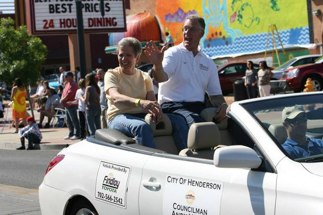 Henderson Mayoral candidate Andy Hafen and his wife Debi ride in a car during Henderson's annual Heritage Parade on Water Street.