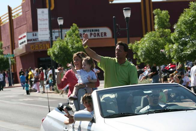 Henderson Mayoral candidate Steve Kirk, right, with his wife Amy and granddaughter Annie ride in a vehicle during Henderson's annual Heritage Parade on Water Street.