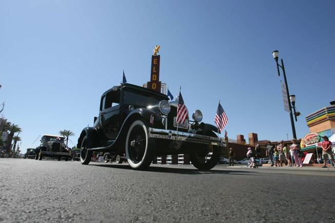 A Model A car cruises along during Henderson's annual Heritage Parade