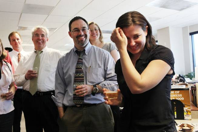 Editorial writers, David Clayton, from left, and Matt Hufman, share in remarks and champagne with reporter Alexandra Berzon on Monday in celebration of the Las Vegas Sun winning the Pulitzer Prize for public service for exposing a high death rate among construction workers on the Las Vegas Strip, at the Las Vegas Sun offices.