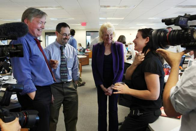 Deputy managing editor Drex Heikes, from left, editorial writer Matt Hufman, and reporters Mary Manning and Alexandra Berzon chat during a gathering to celebrate the Las Vegas Sun's win of the Pulitzer Prize for public service on Monday.