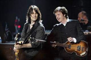 Rusty Anderson and Paul McCartney, shown early in the show.