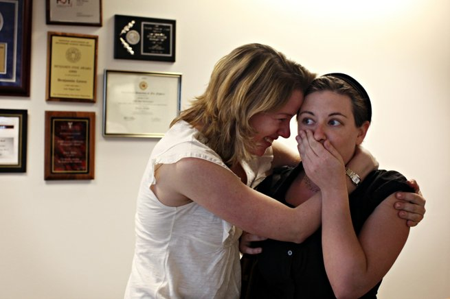 Reporter Emily Richmond, left, embraces reporter Alexandra Berzon as she learns Monday of the Las Vegas Sun's win of the Pulitzer Prize for public service for exposing a high death rate among construction workers on the Las Vegas Strip.