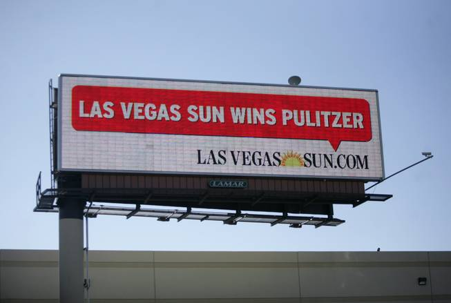 A billboard along Interstate 215 near the McCarran International Airport exit displays a message announcing the Sun's Pulitzer Prize win on Monday.