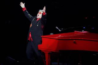 Elton John sings during his final performance of