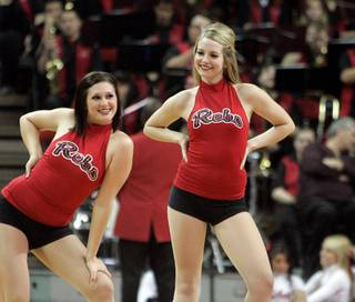 Rebel Girl Lindsay Bennett, right, dances with her team during a UNLV men's basketball game at the  Thomas & Mack Center in Las Vegas, Saturday, Feb. 14, 2009.