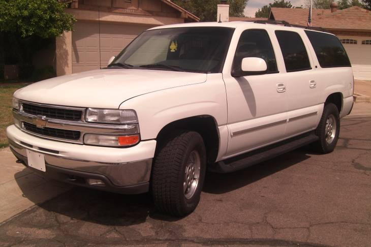 White 2002 Chevrolet Suburban LT 1500, with a gray, leather interior bearing both Arizona license plates 379-ZYE and D230S3. This vehicle was one of two used to drive victims around town.