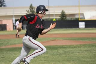 Las Vegas High catcher Bryce Harper runs to first base during the Wildcats' game against Chaparral Apr. 23.
