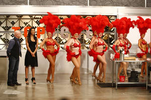 Showgirls line up alongside judges Padma Lakshmi and Tom Colicchio during