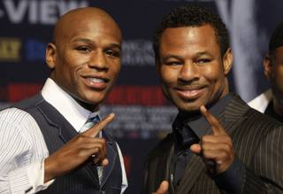 Undefeated welterweight boxer Floyd Mayweather Jr., left, and WBA welterweight champion Shane Mosley pose during a news conference at the MGM Grand Wednesday, April 28, 2010. The fighters will meet for a welterweight bout at the MGM Grand Garden Arena Saturday.