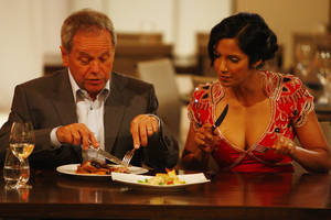 Chef Wolfgang Puck and judge Padma Lakshmi sample food on the first episode of <em>Top Chef: Las Vegas</em>