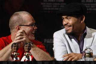Junior welterweight boxer Manny Pacquiao, right, of Philippines talks with his trainer Freddie Roach during a news conference at the MGM Grand Hotel and Casino in Las Vegas, Nevada April 29, 2009. Pacquiao will face Ricky Hatton of England for a 12-round bout at the MGM Grand Garden Arena on Saturday. STEVE MARCUS / LAS VEGAS SUN