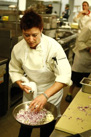 Chef Robin Leventhal cooks up onions during Top Chef sixth season.