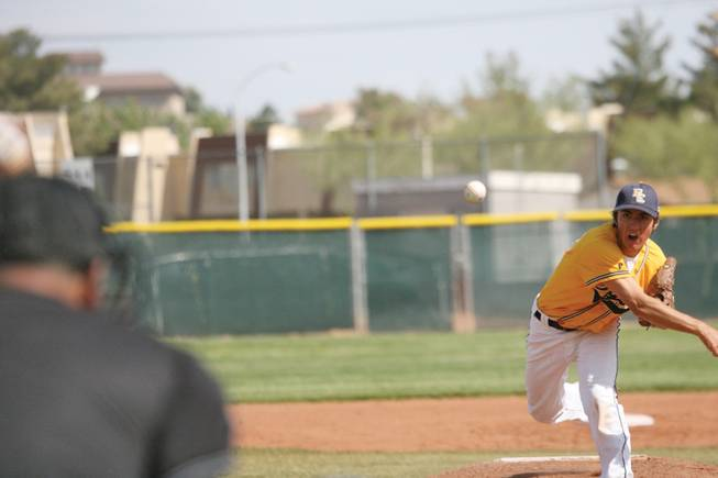 Boulder City High's Adam Eudy throws a pitch during a home game against Moapa Valley on April 24.
