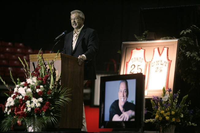 "UNLV announcer Dick Calvert speaks at a memorial for Glen ""Gondo"" Gondrezick Thursday, April 30, 2009 at the Thomas & Mack. Gondo, a 17-year radio and television analyst for UNLV, was a member of UNLV's first Final Four team and a veteran of six seasons in the NBA. He died Monday from complications of a heart transplant."
