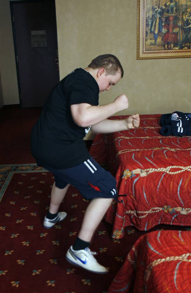 James Bowes, 20, a friend of Ricky Hatton from England, shows off his ring dance during an interview at his hotel room in Las Vegas Thursday, April 30, 2008. Bowes, who was born with hydrocephalus, water on the brain, is making his first trip to the United States this week to watch his favorite fighter.