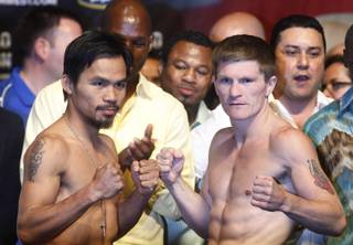 Junior welterweight boxers Manny Pacquiao, left, of the Philippines and Ricky Hatton of Britain pose during an official weigh-in at the MGM Grand Garden Arena in Las Vegas, Nevada May 1, 2009. The boxers will meet for a 12-round title bout at the arena Saturday.