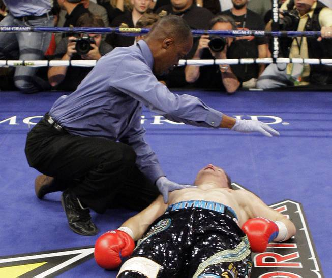 Referee Kenny Bayless checks on British boxer Ricky Hatton after he was knocked out by Manny Pacquiao, of the Philippines, in the second round of their junior welterweight title boxing match Saturday, May 2, 2009, at the MGM Grand in Las Vegas.