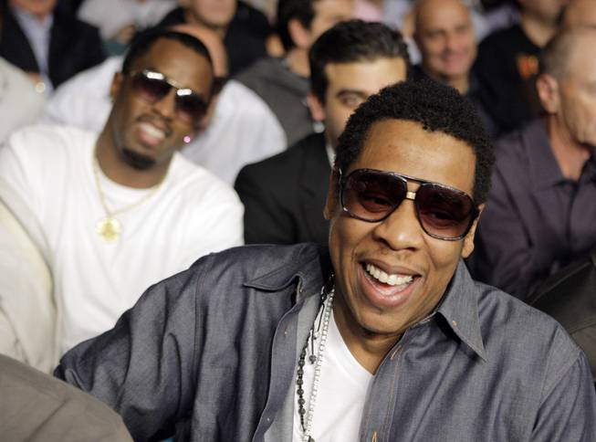 "Music producer Jay-Z, right, sits in front of Sean ""Diddy"" Combs before the junior welterweight title boxing match between British boxer Ricky Hatton and Manny Pacquiao, of the Philippines, Saturday, May 2, 2009, at the MGM Grand in Las Vegas."