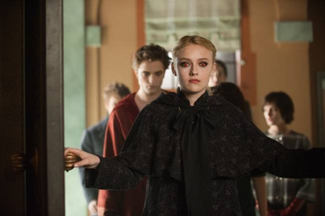 "In this film publicity image released by Summit Entertainment, Dakota Fanning is shown in a scene from ""The Twilight Saga: New Moon."""