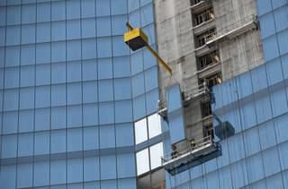 Employees of Z Glass install the glass panels that make up the exterior of the Fountainebleau hotel and casino.