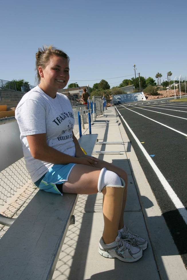 Boulder City High freshman Danyell Harding poses for a photo last week at the school's track. Harding, who competes in the the discus and shot put for the Eagles, had her right leg amputated below the knee as an infant.