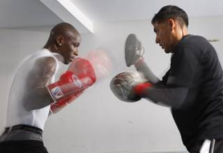 Former light heavyweight champion Antonio Tarver, left, works on his timing with assistant trainer Joe Ponce at Bones Adam's Boxing Gym in Las Vegas Wednesday, May 6, 2009. Tarver will attempt to regain the IBF title he lost to Chad Dawson when the boxers meet for a rematch at the Hard Rock on Saturday.