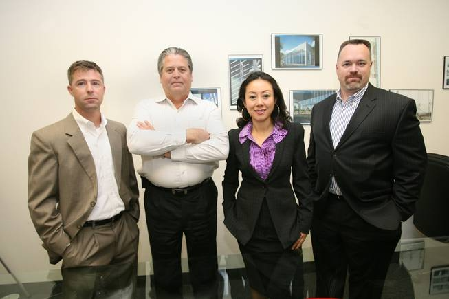 Zetian System Inc. CEO Weina Zhang, center right, and company president Greg Olin, second left, pose with Z Glass Inc. President Steve Miller, left, and vice president Anthony Taylor.