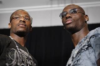 IBF light heavyweight champion Chad Dawson, left, and former champion Antonio Tarver pose during a news conference at the Hard Rock hotel Thursday, May 7, 2009. Dawson will attempt to retain the title that he took from Tarver when the boxers meet for a rematch at the Hard Rock on Saturday.