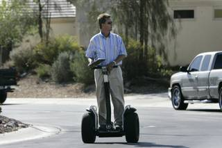 Henderson City Councilman Steve Kirk uses a Segway as he canvasses an Anthem neighborhood on Thursday in his bid for mayor.