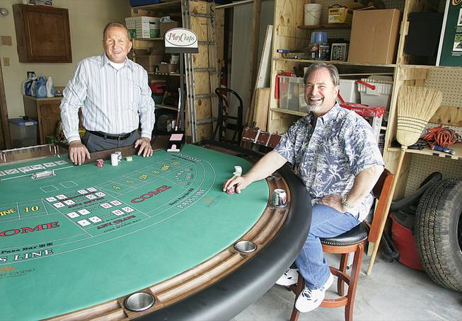 Michael Christian, left, and Jack Chappell are the inventors of Play Craps, a version of craps played with cards instead of dice. A big part of developing the game was designing the special table.
