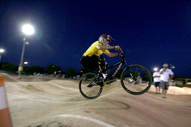 Metro Officer Michael Kaczmerk rides with Boulder City youth during BMX Is Not A Crime