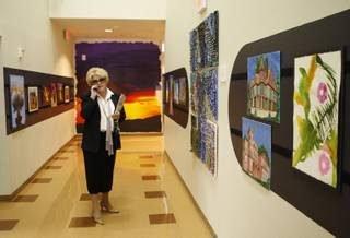 Meadows School president Carolyn Goodman takes a phone call in a hallway filled with student artwork at the school in Summerlin Monday, May 11, 2008. The private school is celebrating its 25th anniversary.