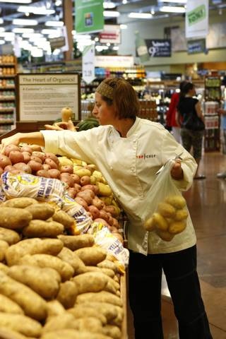 Laurine picks out potatoes on Top Chef: Las Vegas.