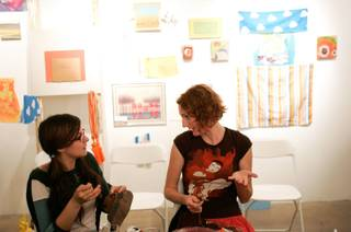 Kiva Singh, left, and Becky Bosshart talk and work on their textile projects during a Bouse House textile workshop organized by artist Danielle Kelly to coincide with her exhibit at Henri & Odette Gallery in Las Vegas on Thursday, May 14, 2009.