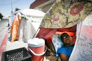 A man who wished not be identified sits inside his tent in the homeless encampment on Foremaster Lane between Las Vegas Boulevard North and Main Street in Las Vegas on Friday, May 15, 2009.