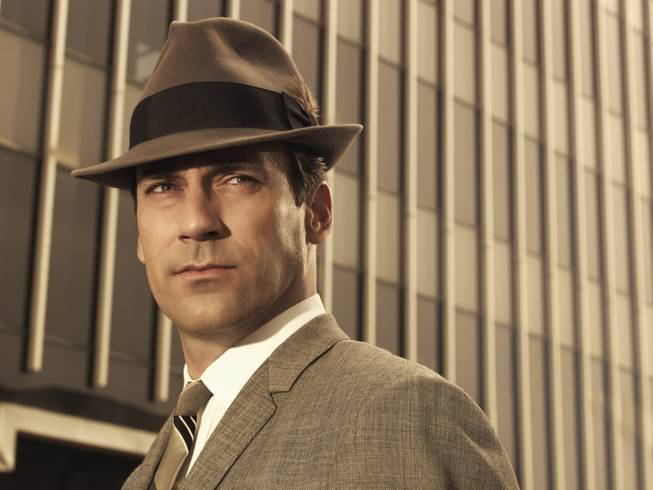 "Jon Hamm as Don Draper in ""Mad Men"".  The show has helped bring back the '60s, including hats."