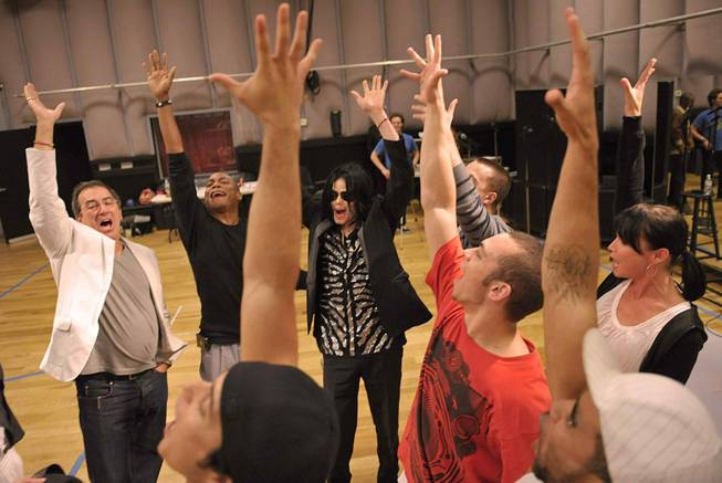 Kenny Ortega and Michael Jackson with the 12 dancers selected for Michael's upcoming This Is It concert run at London's O2 Arena. The dancers were chosen from 5,000 applicants.