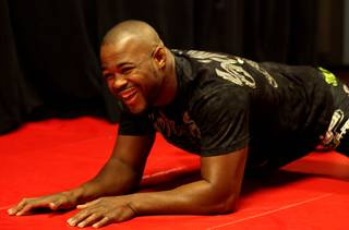 UFC light heavyweight champ Rashad Evans goofs around with media members during a workout Wednesday at the MGM Grand Garden Arena. Evans takes on undefeated Lyoto Machida at UFC 98 Saturday night.