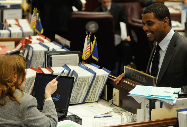 Senate Majority Leader Steven Horsford, D-Las Vegas, talks to Sen. Maggie Carlton, D-Las Vegas, during a Senate floor session at the Legislature in Carson City on Wednesday, May 20, 2009.