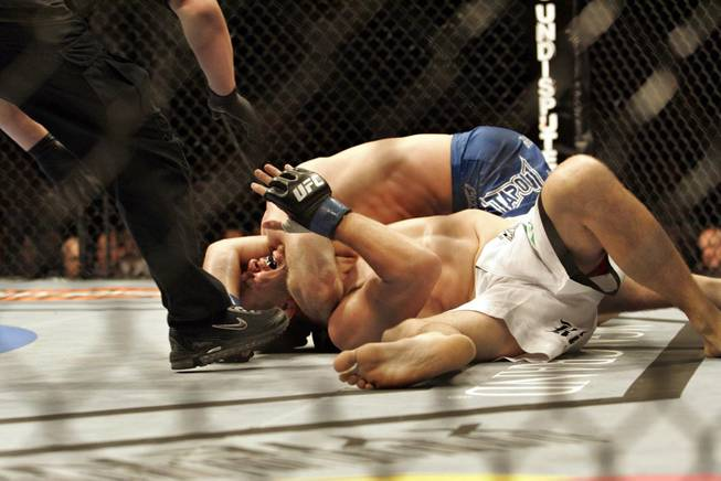 Mike Pyle, bottom, taps out in his welterweight against Brock Larson at UFC 98 at MGM Grand Garden Arena in Las Vegas on Saturday, May 23, 2009.