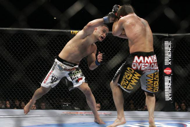 Frank Edgar, left, connects with Sean Sherk during their lightweight fight at UFC 98 at the MGM Grand Garden Arena in Las Vegas on Saturday, May 23, 2009. Edgar put on an impressive boxing performance to score a unanimous decision victory.