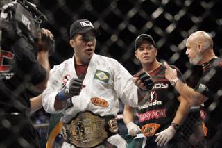 New light heavyweight champ Lyoto Machida poses after claiming the title with a second-round knockout of Rashad Evans at UFC 98 at the MGM Grand Saturday, May 23, 2009.