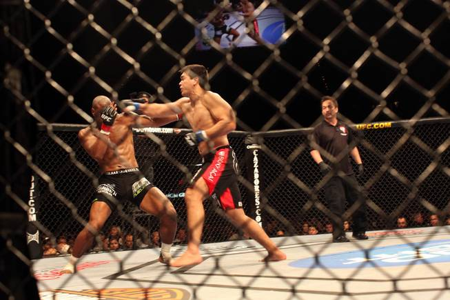 Rashad Evans, left, gets knocked out at the end of the second round in his bout with Lyoto Machida in UFC 98 at the MGM Grand Garden Arena in Las Vegas on Saturday, May 23, 2009.